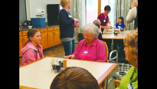 Hayden Wempen and Mills Harbour resident, Marilyn Fjeld, visit about their pen pal letters.