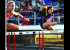 Dana Baumann clears the first hurdle in the shuttle hurdle relay.