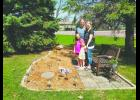 Brian and Jill Budach, and daughters Makenzie, 9, and Kalli, 4, spend some time in Taryn's Garden. The garden was created in memory of the daughter who was born prematurely, approximately six and one-half years ago. She lived only a little over a month.